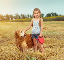 happy little girl with her dog