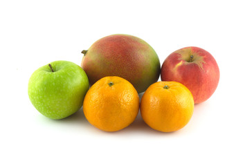 Ripe appetizing fruits: mango, apples and tangerines isolated