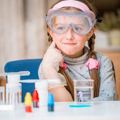 girl with flasks for chemistry