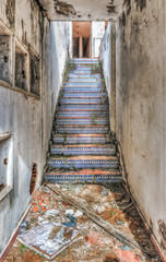 Derelict azulejos tiled stairway in an abandoned resort