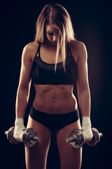attractive young woman working out with dumbbells - bikini fitne