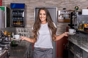 Beautiful caucasian waitress smiling in the coffee shop.