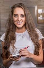 Beautiful caucasian waitress smiling in the coffee shop.