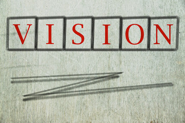 vision writen on a wall background