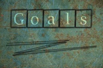 goals writen on a wall background