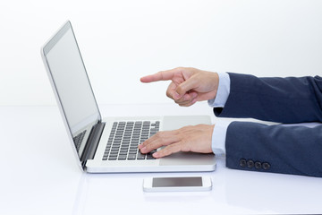 Businessman hands typing on laptop computer