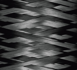 Texture of Carbon Kevlar Fiber material. Dark background