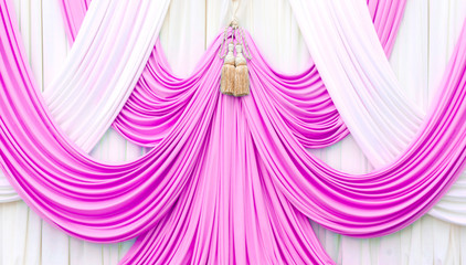 pink and white curtain on stage