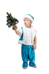 Little boy holding a Christmas tree in his hand