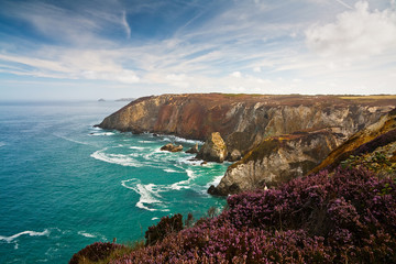 Cliffs coloured by different minerals, Cornwall, UK.