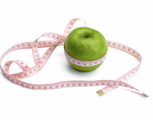 A green apple and a measurement tape , isolated on white