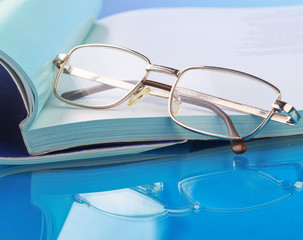 Glasses lying on a book.