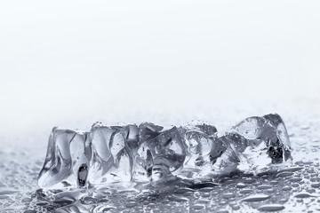 melting ice on white background