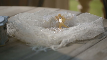 Tissue box and pearls on the table shot with slider