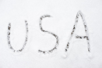 inscription usa on snow-covered ice