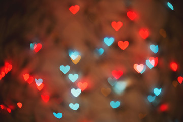 Color Bokeh on a dark background with hearts for use in graphic