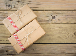 parcels  wrapped in brown paper and string with red check ribbon