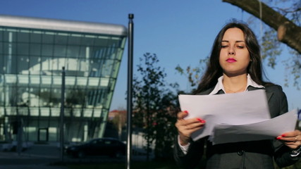 Businesswoman working on papers and smiling, steadycam shot