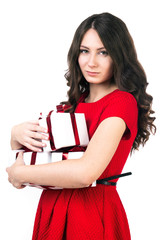 Girl with presents on a white background in a red dress