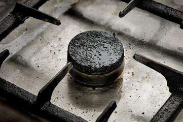 Dirty gas burner closeup