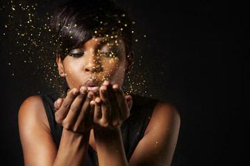 woman blowind star dust
