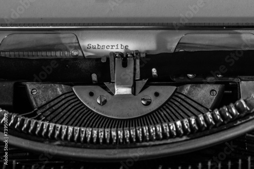 "Typewriter with the ""Subscribe"" text typed on a white paper. Poster"