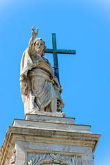 Statue at the top of Basilica of Saint John Lateran in Rome, Ita