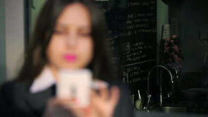 Blurred businesswoman texting on cellphone