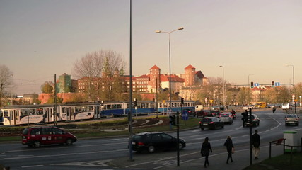 View of old castle in the city and traffic circle