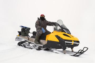 Fisherman on a snowmobile