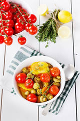 baked potatoes with carrots, mushrooms and cherry tomatoes