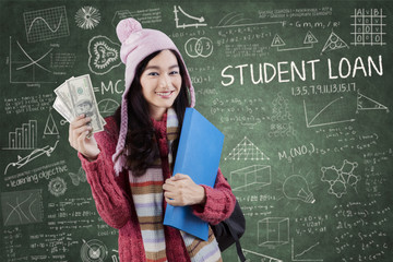 College girl with money in class
