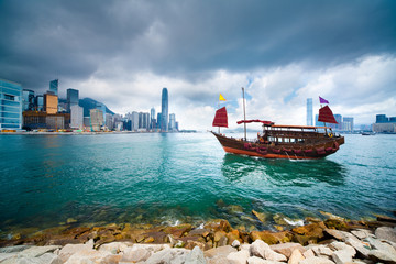 Traditional Chinese Junkboat sailing in Victoria Harbour, Hong