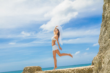 young happy beautiful woman outdoor portrait, beach and sky back