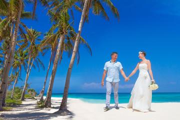 young loving couple on tropical sand beach, outdoor beach weddin