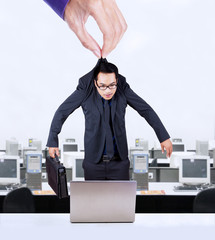 Hand holding worker in office
