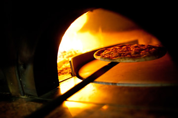 A pizza in a oven burning