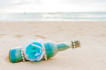 glass bottle with colored sand on natural background, sand cerem