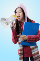 Lovely student yelling with a megaphone