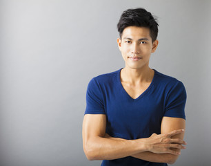 smiling muscular asian young man