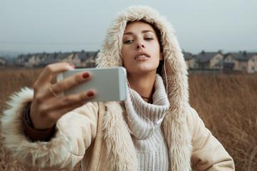 woman takes selfies close up