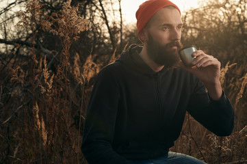 bearded lumberjack drinks tea