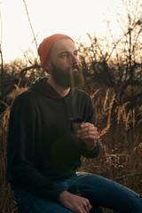 bearded lumberjack drinks tea