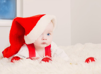 baby in red Christmas hat