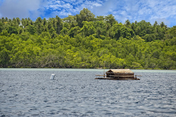 Small wood floating fishing platform