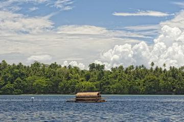 Small wood floating fishing platform