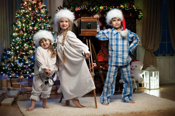 Children in the New Year with the camera interior