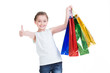 Pretty smiling little girl with shopping bags