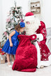 Curious little girl looks in a bag on Saint Nicolas