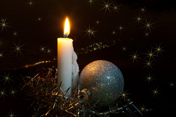 Big burning candle and New Year's Christmas tree decorations